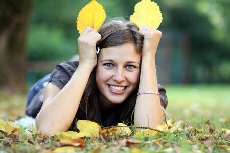 beautiful young woman relaxing in the grass  Stock Photo - 5512360