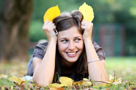 beautiful young woman relaxing in the grass  Stock Photo - 5512370