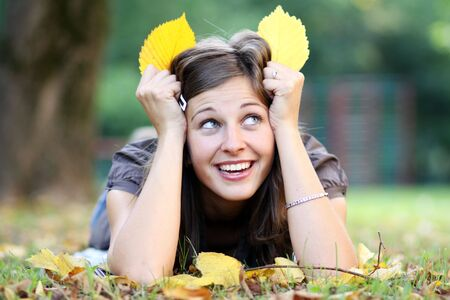 beautiful young woman relaxing in the grass  Stock Photo - 5512369