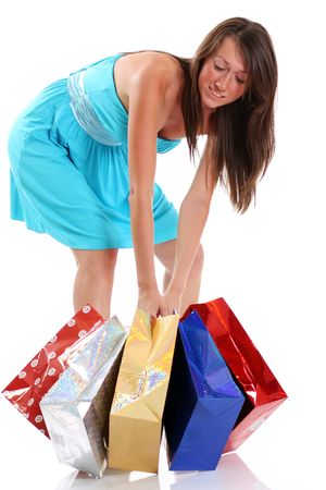 portrait of one happy young adult girl with colored bags  Stock Photo - 5643175