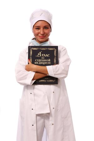 smock:  Young female Hispanic nurse in a lab coat with a stethoscope