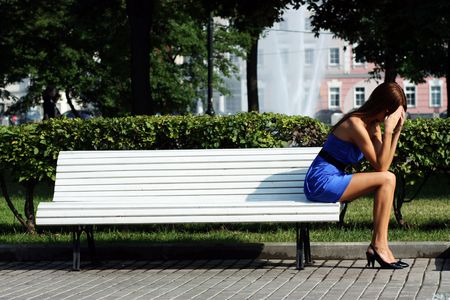 girl has a rest sitting on a bench in park  Stock Photo