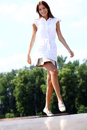 step: young beautiful girl walks in outdoor
