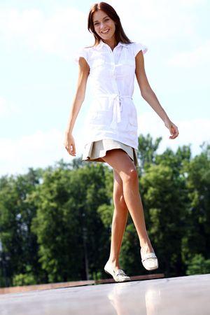 young beautiful girl walks in outdoor
