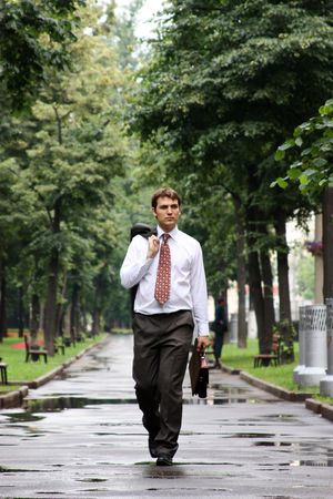 businessman walking on the street photo