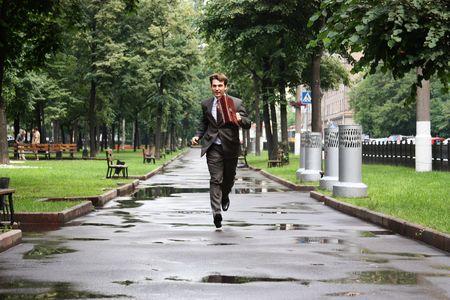 businessman walking on the street photo