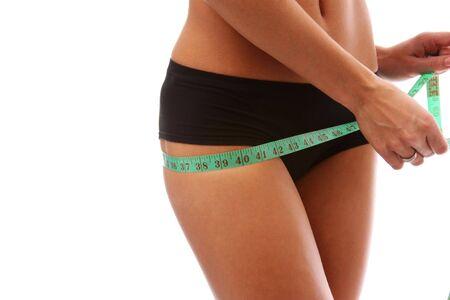 Woman measuring perfect shape of beautiful thigh Stock Photo - 5844411
