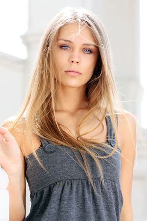 18's: Beautiful woman standing against wall in background  Stock Photo