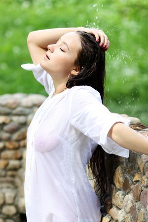 Sexy young woman in white wet men's shirt Stock Photo - 5942574
