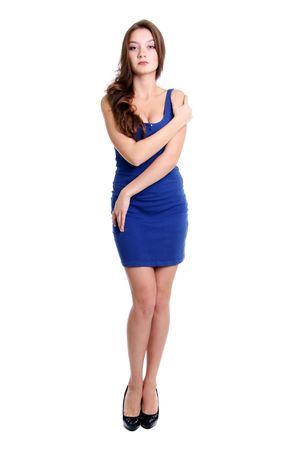Full length of a beautiful young lady in  dress standing against isolated white background  photo