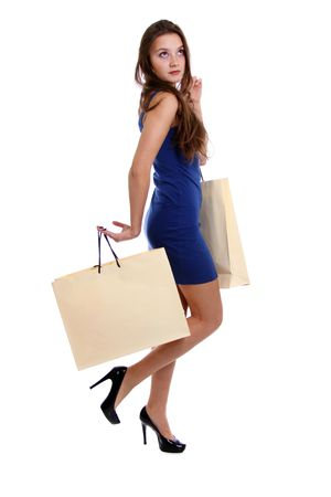 Shopping woman smiling. Isolated over white background  Stock Photo - 6105839