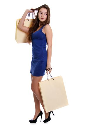 Shopping woman smiling. Isolated over white background Stock Photo - 6105824