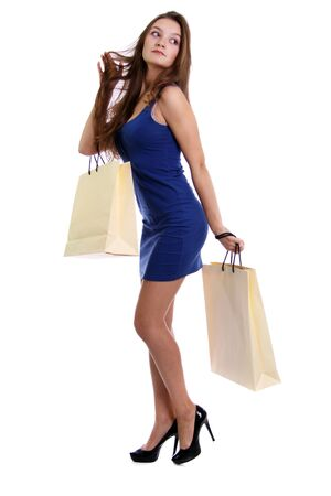Shopping woman smiling. Isolated over white background Stock Photo - 6105835