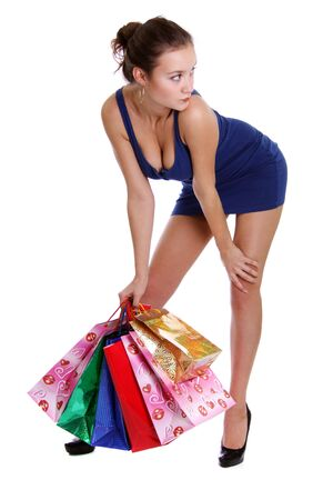 boxing day sale: Shopping woman smiling. Isolated over white background  Stock Photo