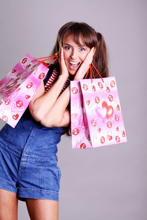 Shopping woman smiling. Isolated over white background Stock Photo - 6106426