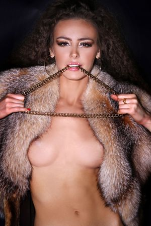 Sexual model in a fur coat Stock Photo