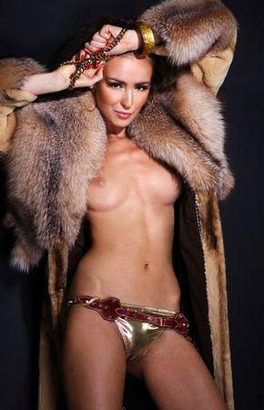 Sexual model in a fur coat Stock Photo