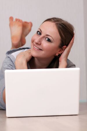 Closeup portrait of a young woman using laptop Stock Photo - 6564588