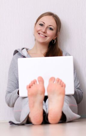portrait of a young woman using laptop Stock Photo - 6735487