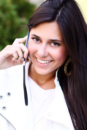 Happy young lady talking on mobile phone Stock Photo - 6750688
