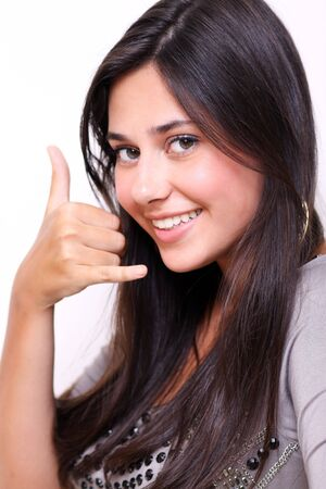 call me: picture of lovely woman making a call me gesture