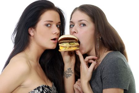 Two girls divide one sandwich Stock Photo - 6765024