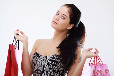 Shopping woman smiling. Isolated over white background Stock Photo - 6764816