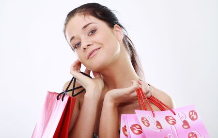 Shopping woman smiling. Isolated over white background Stock Photo - 6765070