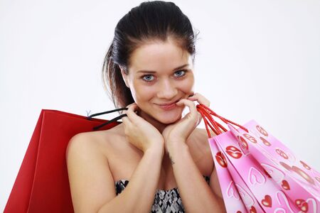 Shopping woman smiling. Isolated over white background Stock Photo - 6763282