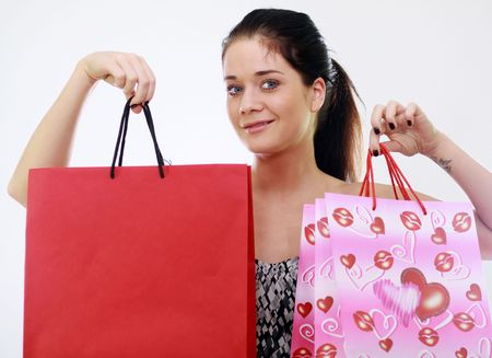 Shopping woman smiling. Isolated over white background Stock Photo - 6764543