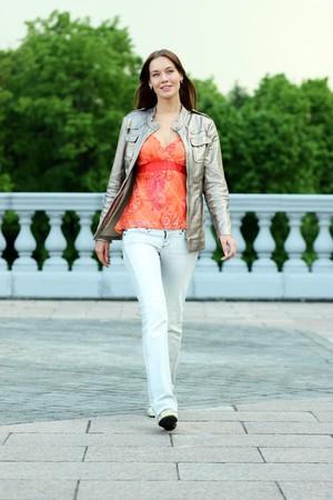 healthy path: Full length, walking woman in blue jeans