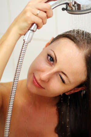 young beautiful woman relaxing taking a shower photo