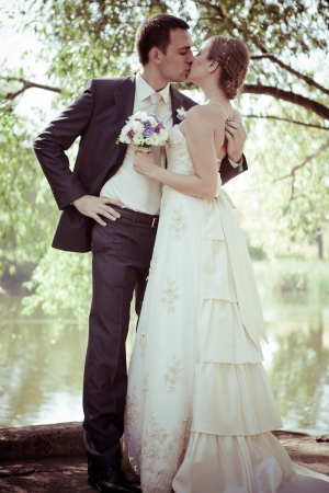 young couple hugging kissing: Bride and groom  Stock Photo