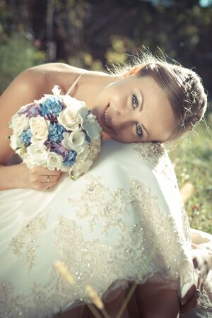 Portrait of the young beautiful bride photo