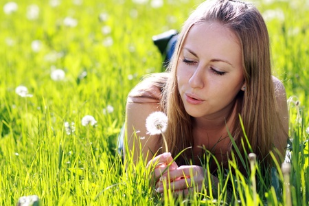 pollens: Dandelion - The girl blows on a dandelion  Stock Photo