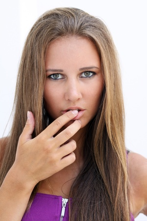licking finger: closeup of sexy female face with finger in mouth
