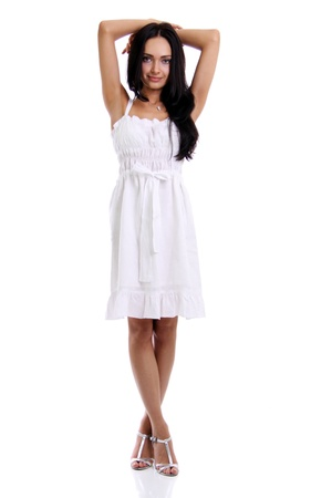 Full length of a beautiful young lady in  dress standing against isolated white background Stock Photo - 8527964