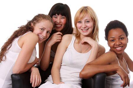 four person: four beautiful ethnic women in studio Stock Photo