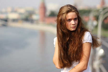 upset woman: Beautiful young woman. Outdoor portrait  Stock Photo