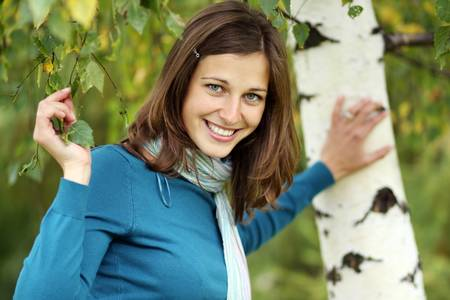 Russian beauty - the happy girl at a white birch  photo