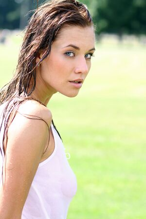 wet lips: beautiful young woman in summer park