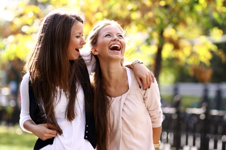 Two cheerful girls twins, in the street Stock Photo
