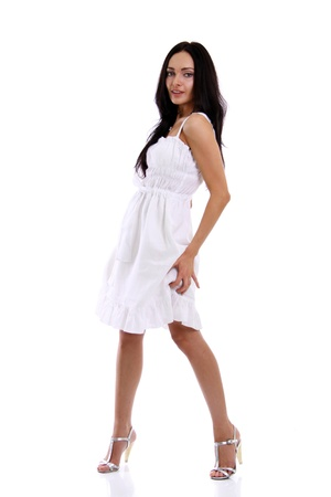 Full length of a beautiful young lady in  dress standing against isolated white background  Stock Photo - 8637814