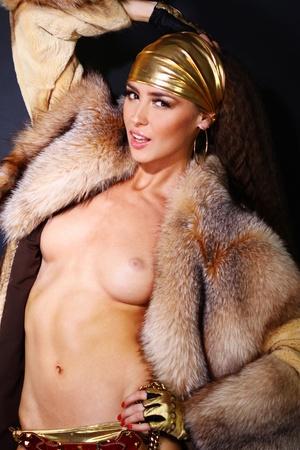 Sexual model in a fur coat Stock Photo - 8639548