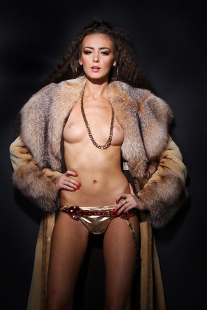 Sexual model in a fur coat Stock Photo - 8639509