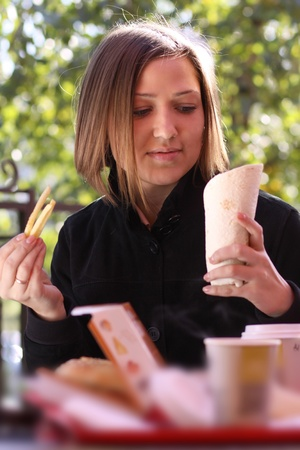 shopping binge: Woman Eating Lunch At A Cafe
