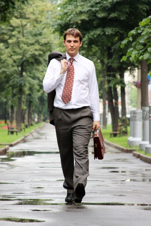 goes: businessman walking on the street Stock Photo
