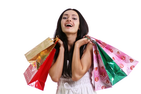 Shopping woman smiling. Isolated over white background  Stock Photo - 9513549