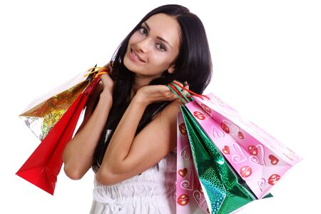 Shopping woman smiling. Isolated over white background  Stock Photo - 9513432
