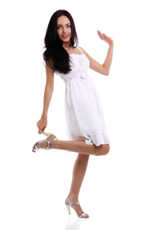 Full length of a beautiful young lady in  dress standing against isolated white background Stock Photo - 9509562